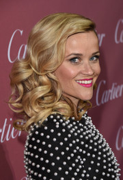 Reese Witherspoon amped up the girly vibe with a swipe of pink lipstick.