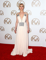 Jennifer Lawrence stole the show in a stunning gown with metallic accents and a very deep plunge!