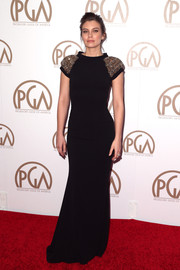 Lauren Cohan arrived at the 26th Annual Producers Guild Of America Awards in a sleek black dress with exciting heavily embellished shoulders.