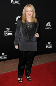 Jacki shines in a satin black pant suit and dramatic silver statement necklace at the Santa Barbara Film Festival.