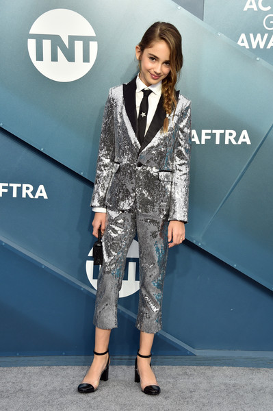 Julia Butters teamed her suit with black ankle-strap pumps by Chinese Laundry.