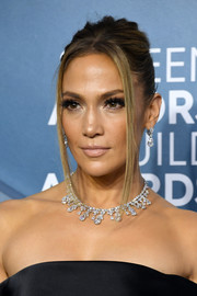 Jennifer Lopez rocked a mildly messy updo at the 2020 SAG Awards.
