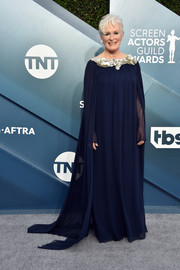Glenn Close looked queenly in a caped navy gown with an embellished neckline at the 2020 SAG Awards.