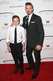 A smart-looking Brooklyn Beckham styled his crisp white shirt with rolled-up cuffs, a slim black tie and slacks.