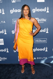 Garcelle Beauvais was a delight to behold in her marigold, pink, and magenta one-shoulder dress at the GLAAD Media Awards.