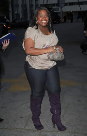 """Glee"" actress Amber Riley attended an event wearing a killer pair of purple boots. She balanced out her colorful boots with a basic t-shirt and cool silver clutch."