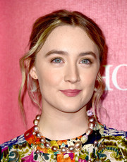 Saoirse Ronan opted for a messy, center-parted updo when she attended the Palm Springs International Film Fest Awards Gala.