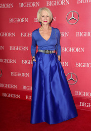 Helen Mirren worked the Palm Springs International Film Fest red carpet wearing a royal-blue cardigan.