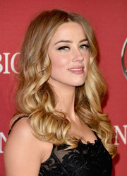 Amber Heard looked like a doll with her long curly 'do at the Palm Springs International Film Fest Awards Gala.