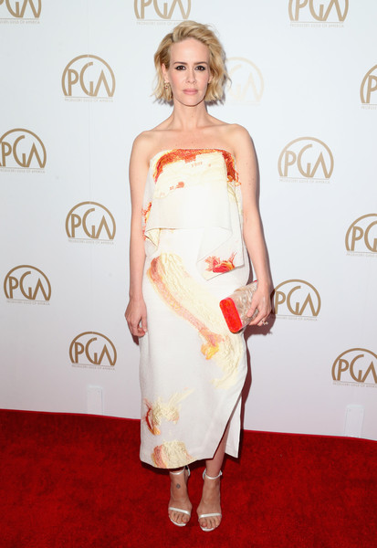 Sarah Paulson chose simple white ankle-strap sandals by Stuart Weitzman to pair with her dress.