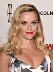 Reese Witherspoon swiped on some rich red lipstick for an extra dose of sexiness.