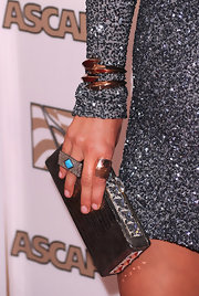 Kesha paired her silver sequin dress with a rectangle cocktail ring with turqouise stones.
