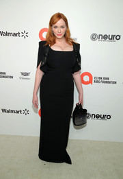 Christina Hendricks attended the 2020 Elton John AIDS Foundation Oscar-viewing party wearing a simple black gown by For Restless Sleepers.