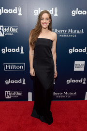 Carly Chaikin opted for a minimalist look with this strapless black column dress when she attended the GLAAD Media Awards.