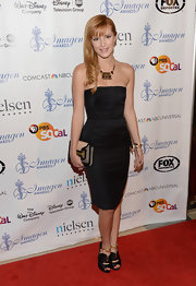 Bella opted for a very mature and polished look with this strapless black dress with waffle-weaving.