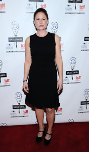 Maura Tierney completed her classic look with a pair of black platform Mary Janes.