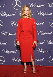 Laura Linney complemented her dress with red ankle-strap satin sandals.