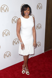 Taraji P. Henson matched her dress with a pair of white crisscross-strap heels.