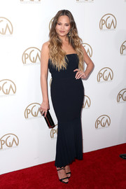 Chrissy Teigen sheathed her famous curves in a strapless mermaid-hem dress by Dion Lee for the Producers Guild Awards.