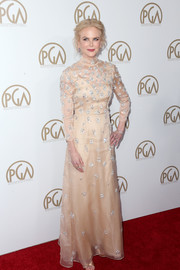 Nicole Kidman looked absolutely breathtaking at the Producers Guild Awards in a long-sleeve nude Prada gown with silver beading.