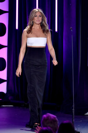 Jennifer Aniston chose a sleek and elegant Kaufmanfranco gown with an illusion midsection and shoulders for the American Cinematheque Award honoring Reese Witherspoon.