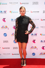 Ksenija Lukich was classic and sexy in a little black lace dress by Manning Cartell at the ARIA Awards.