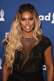 Laverne Cox went for a fairytale vibe with this partially braided wavy hairstyle at the 2018 GLAAD Media Awards.