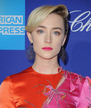 Saoirse Ronan embraced color, pairing a saturated pink lip with her two-tone frock.