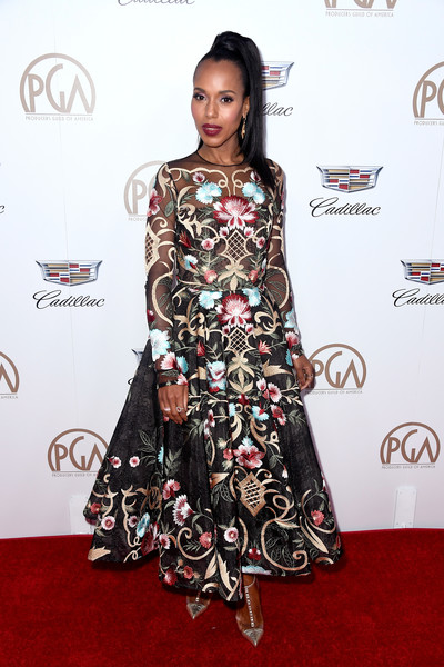Kerry Washington paired her dress with studded gold pumps by Christian Louboutin.