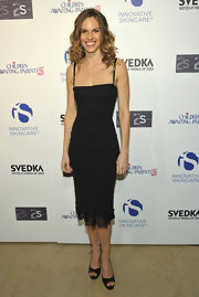 Hilary Swank complemented her sleek black knee length dress with black platform peep toes.
