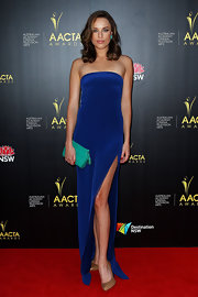 Jessica McNamee looked simply electric in this blue column dress with a hip-high slit.