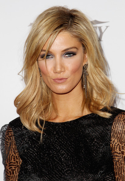Delta Goodrem topped off her look with sexy shoulder-length waves when she attended the Australians in Film Awards Gala.