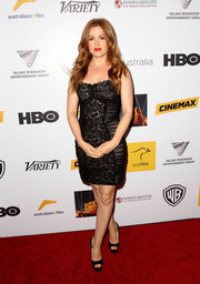 Isla Fisher looked va-va-voom in a strapless black lace corset dress during the Australians in Film Awards Gala.