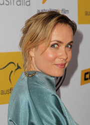 Radha Mitchell pinned her hair up in a soft, romantic updo for the Australians in Film Awards Gala.