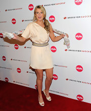 The reality star sported a belted, neutral cocktail dress with ivory pumps and a side ponytail.