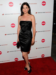 Jodi rocked a glitzy pair of platform slingbacks with a satin cocktail dress.