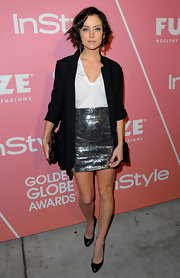 Jessica sparkled in a high-waisted metallic skirt.