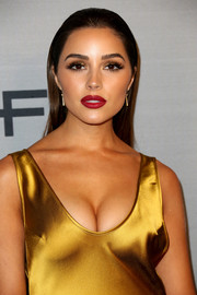 Olivia Culpo's red lipstick worked beautifully with her marigold dress!