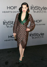 Dita Von Teese complemented her frock with a pair of green satin pumps.