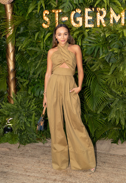 Ashley Madekwe rocked a khaki cutout jumpsuit by Rosie Assoulin at the Maison St-Germain event.