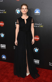 Alice Eve chose an elegant black gown with sheer sleeves and a thigh-high slit for the Rebels with a Cause Gala.