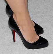 The actress opted for patent leather Louboutin pumps.