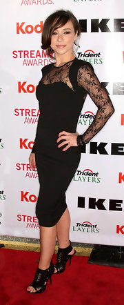 Danielle paired her sultry dress with a pair of strappy heels, which added a hard-edge to her look.