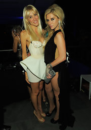 Liv posed with Kesha in her extreme peplum mini dress with a beaded corset top.