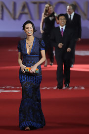 Wendi Deng hit the red carpet in a beautiful oriental-themed gown at the 2nd Beijing International Film Festival.