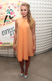 Kristen Bell complemented her flowing peach frock with a pair of icy blue pumps.