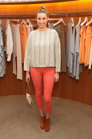 "Whitney Port attended the City of Style event in LA carrying a vintage ostrich and iguana skin ""Arome"" clutch."