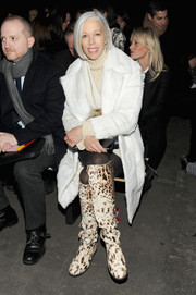 Linda Fargo teamed knee-high animal-print boots with her fur coat for a bolder finish.