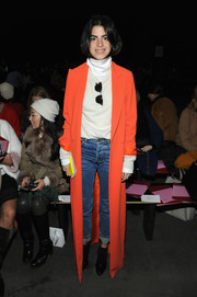 Leandra Medine grabbed attention with her floor-grazing bright orange coat during the 3.1 Phillip Lim fashion show.