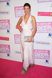 Emma chose a soft pink printed maxi dress for her look on the pink carpet at the 30 Days of Fashion and Beauty event.
